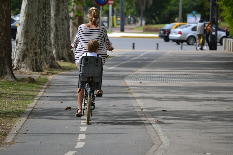 mom with a child on a bike